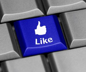 Keyboard with Facebook thumbs up like