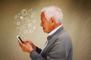 Old man using social media on smart phone