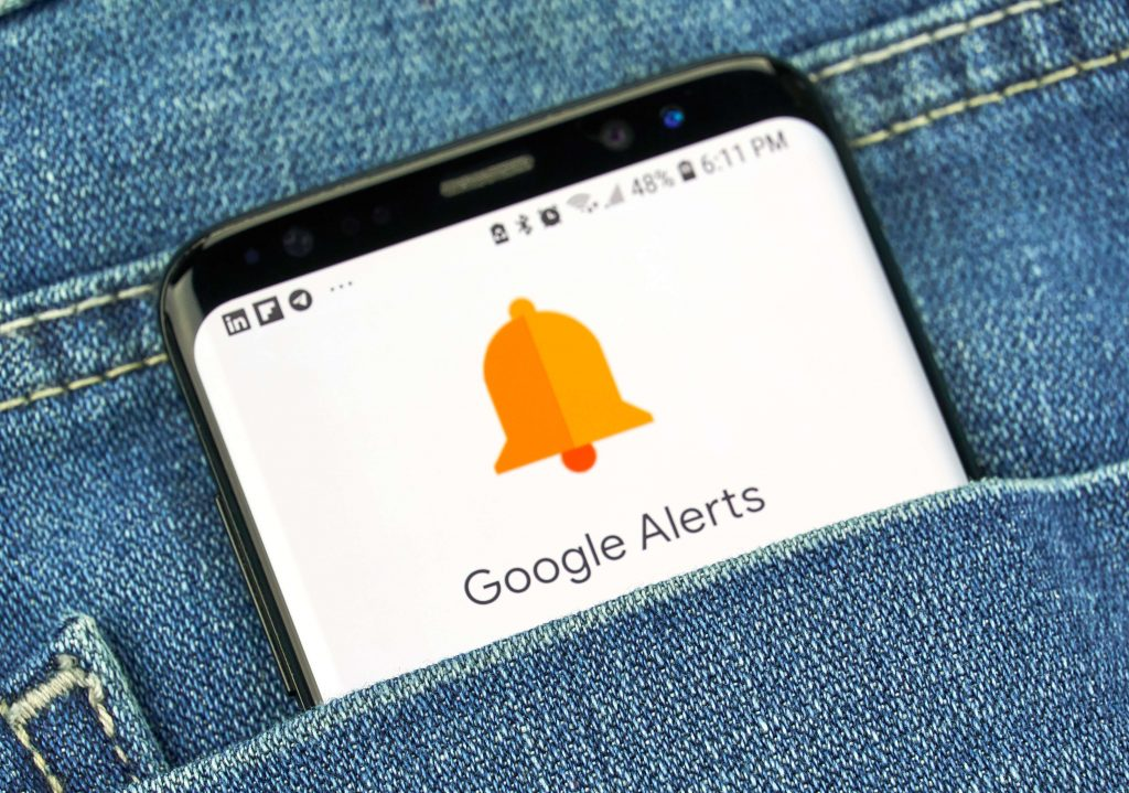 Google alerts on phone in pocket